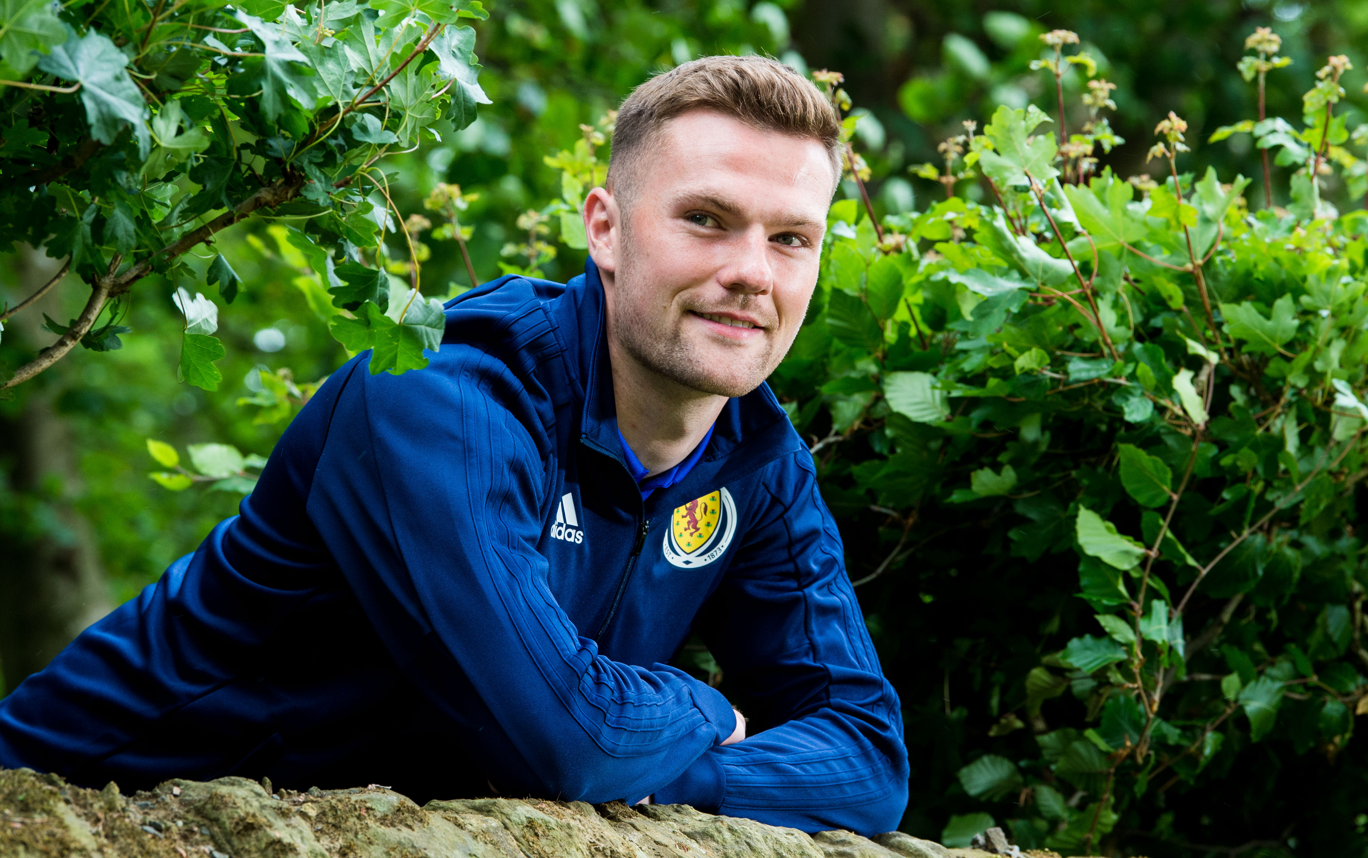 Aberdeen's Mikey Devlin is set to start for Scotland in Moscow tonight.