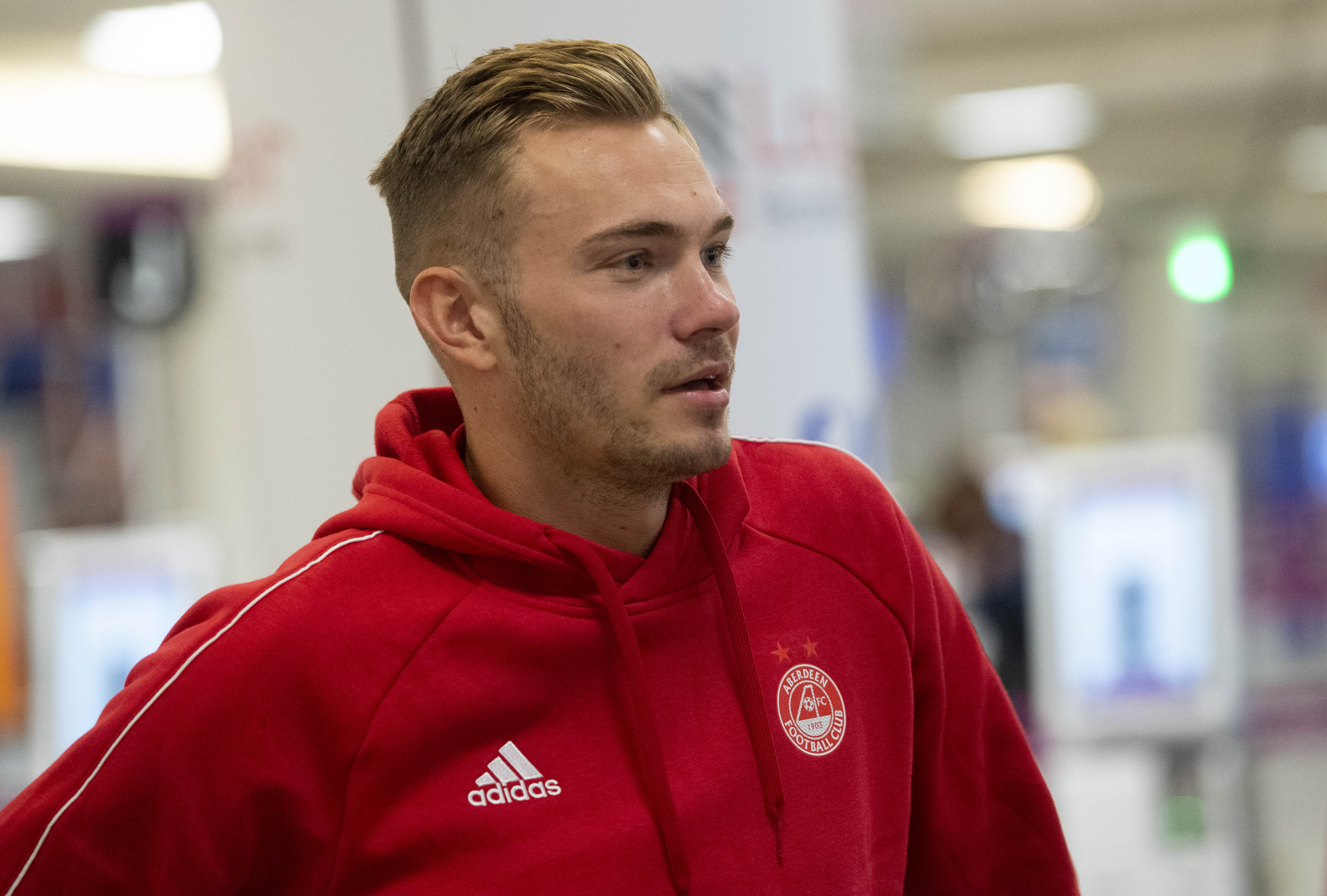 Aberdeen's Ryan Hedges arrives at Edinburgh Airport as the players depart for Ireland.