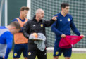 Scotland manager Steve Clarke speaks with Scott McKenna during training for a recent international