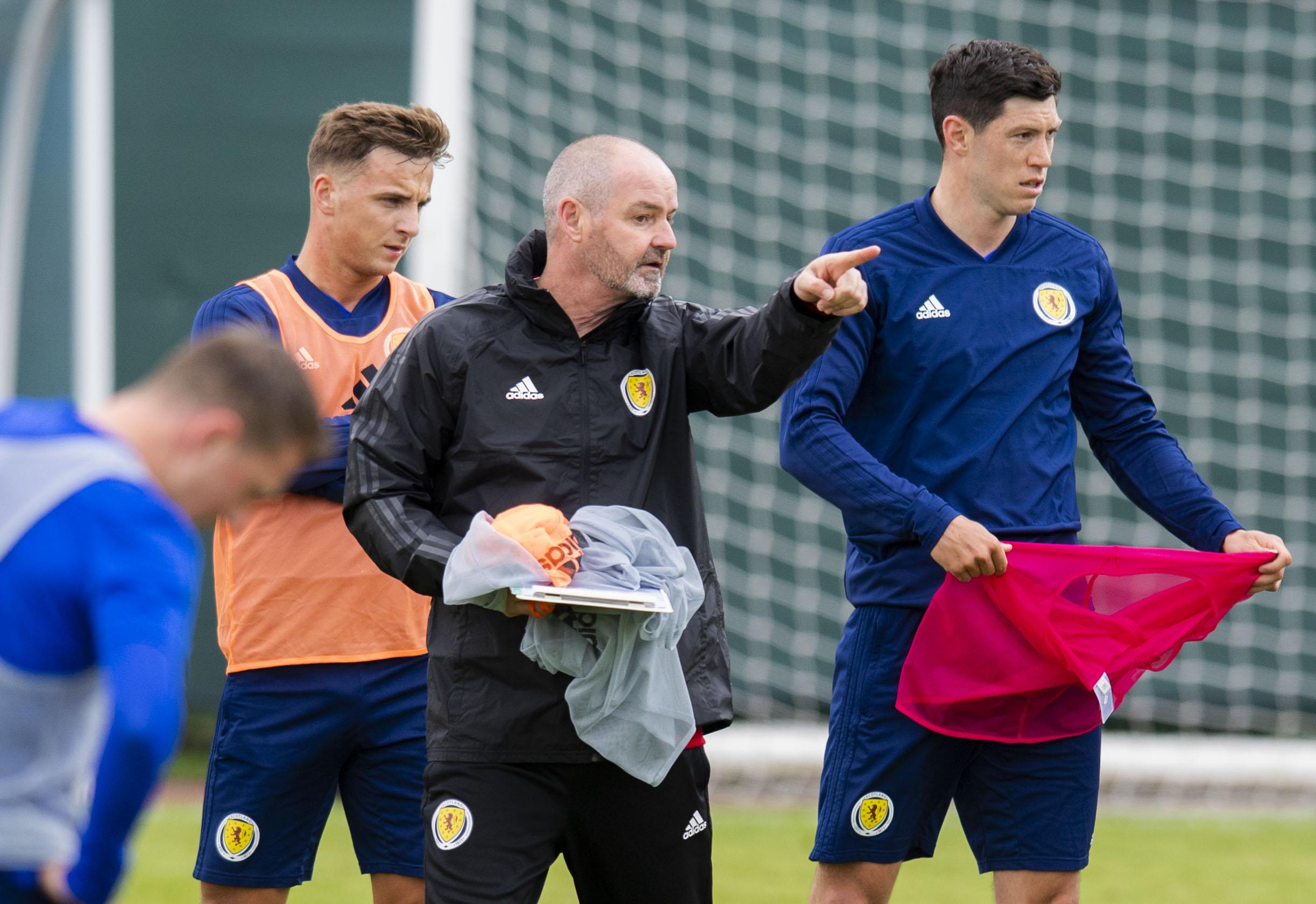 Scotland manager Steve Clarke speaks with Scott McKenna during training for a recent international