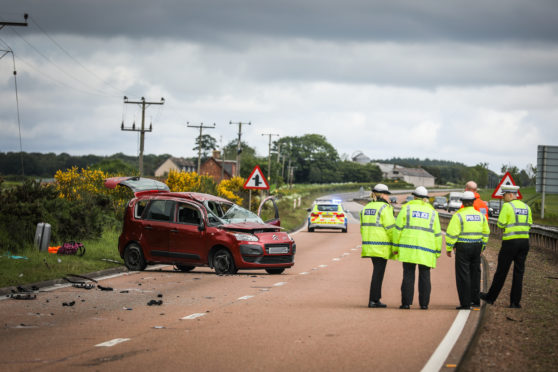 Police at the scene of the crash on the A90