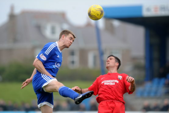 Jamie Redman in action for former club Peterhead