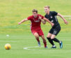 Jon Gallagher in action against Connah's Quay Nomads