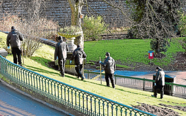 Police at the scene of the alleged assault