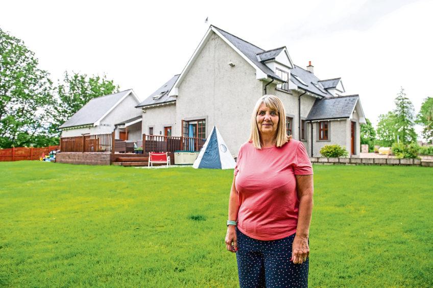 Lynn Dean in the garden of her house, Adensfield, Dalgety, Brechin