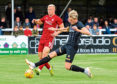 Aberdeen's Curtis Main in action with Inverness CT's Coll Donaldson