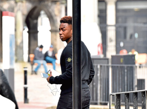 Dons player David Dangana, who was a victim of the alleged assault. leaves Aberdeen Sheriff Court
