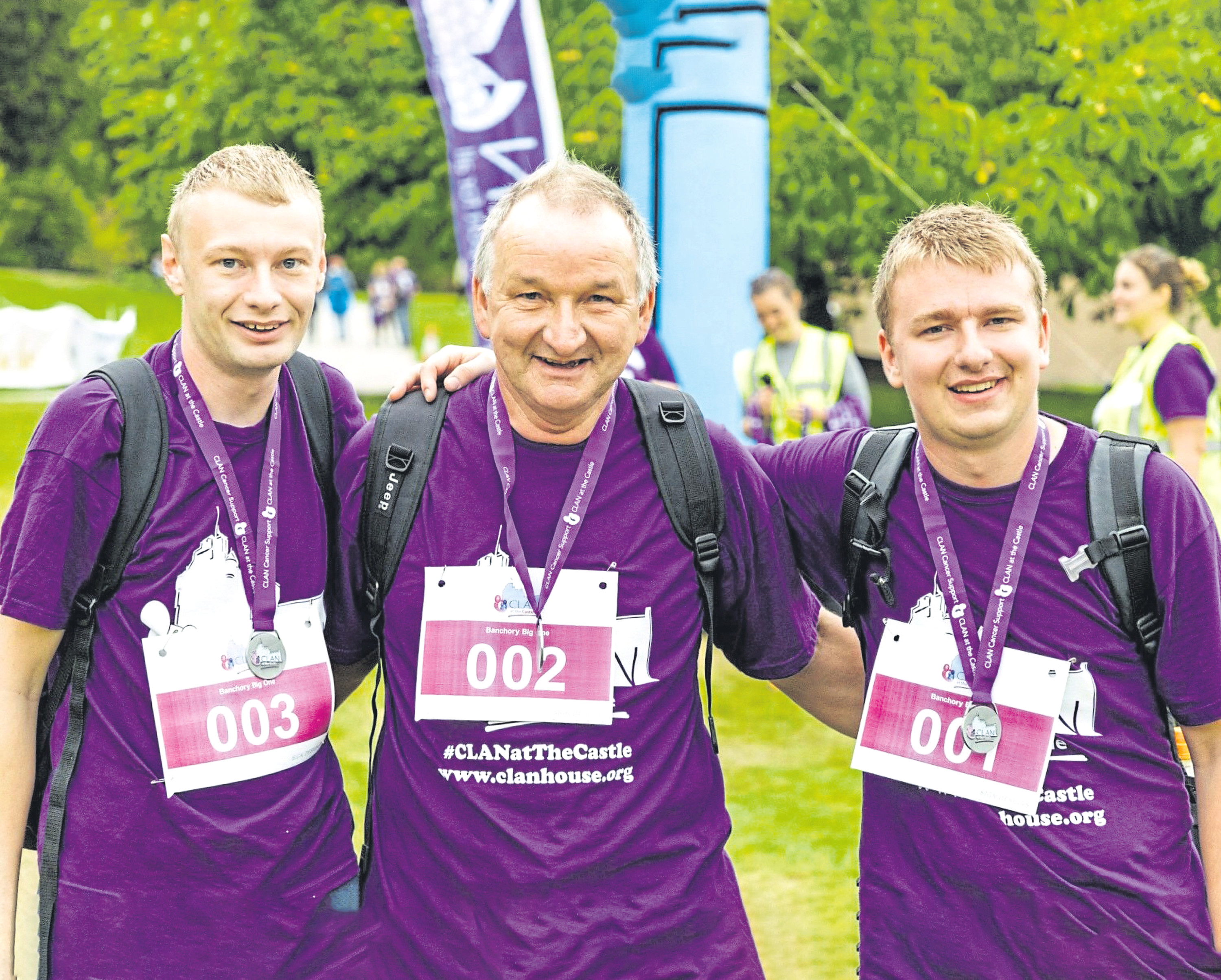 Fraser, Mike and Ross Sangster at the CLAN walk at the castle
