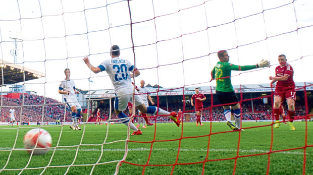 Aberdeen's Jonny Hayes (right) crashes home goal number four