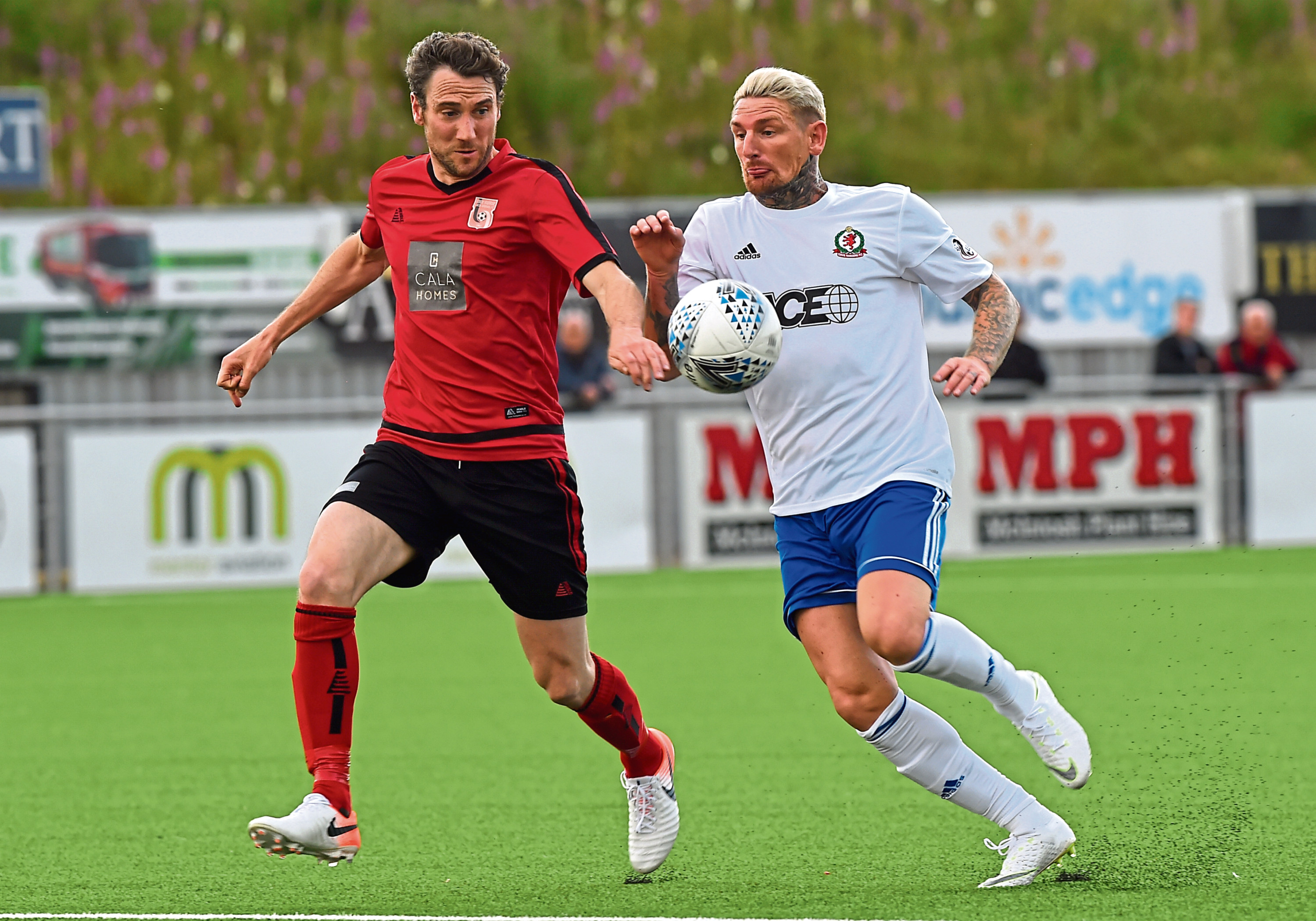 Ryan Broadhurst, left, in action for Inverurie Locos  Picture by KENNY ELRICK