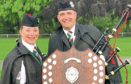 Portlethen and district Pipe Band was crowned European Champions. Pipe sergeant Kevin Urquhart and Pipe Major Julie Brinklow with the trophy