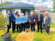 The Leys Group has raised more than £12,000 for Banchory-based charity Forget Me Not Club