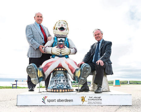 Sport Aberdeen chairman Colin Taylor, left, and Joe Mackie, of the Archie Foundation, launch the Big Bucket Trail link-up with vintage clown Oor Wullie at the beach