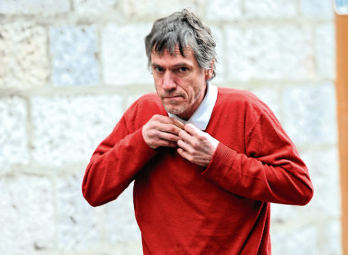 Michael Davidson was fined £500 after assaulting an officer and struggling with another in Westhill