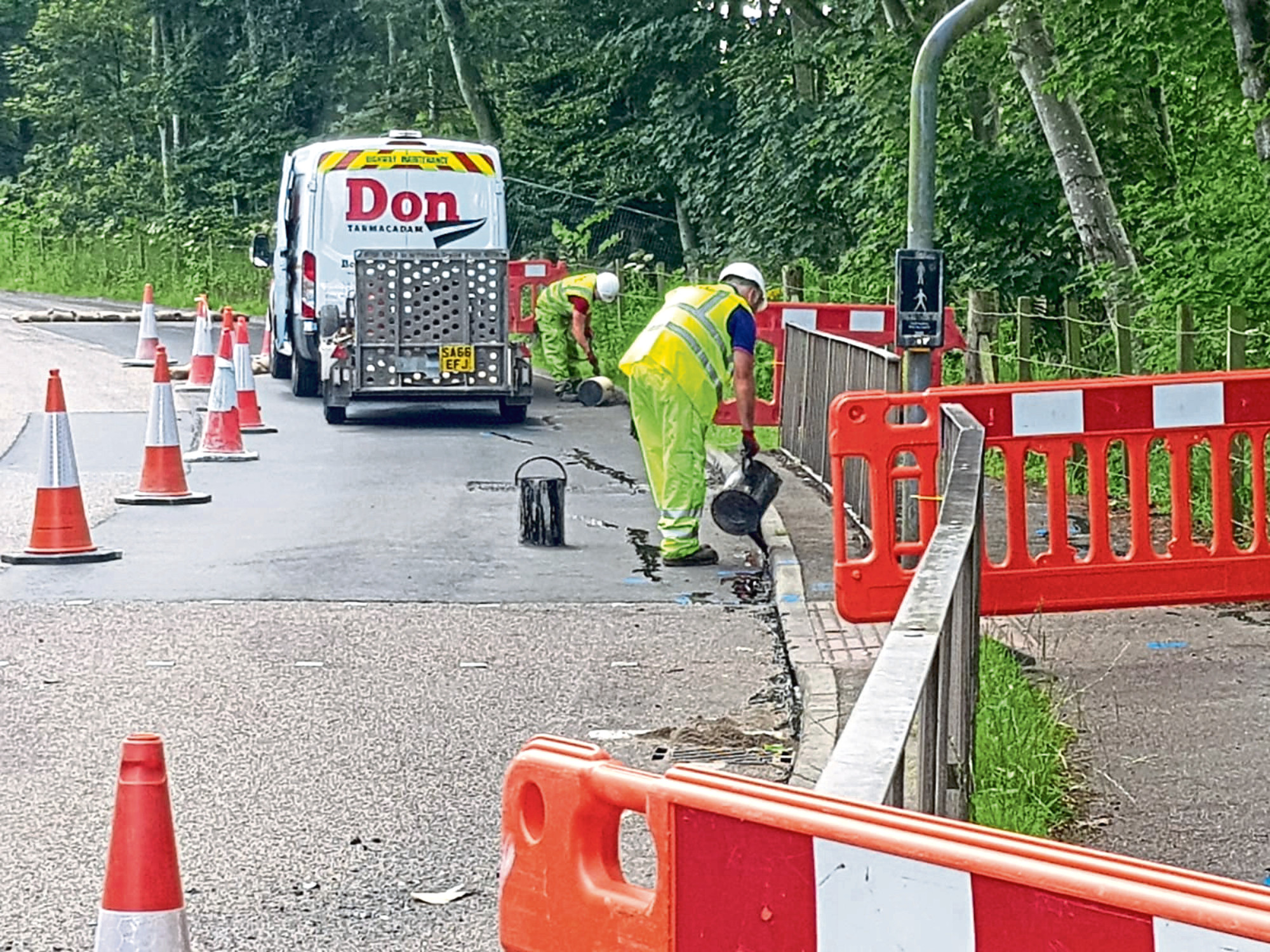 Workers on the A957
