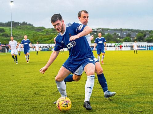 Cove Rangers Daniel Higgins and Paul McGowan in action