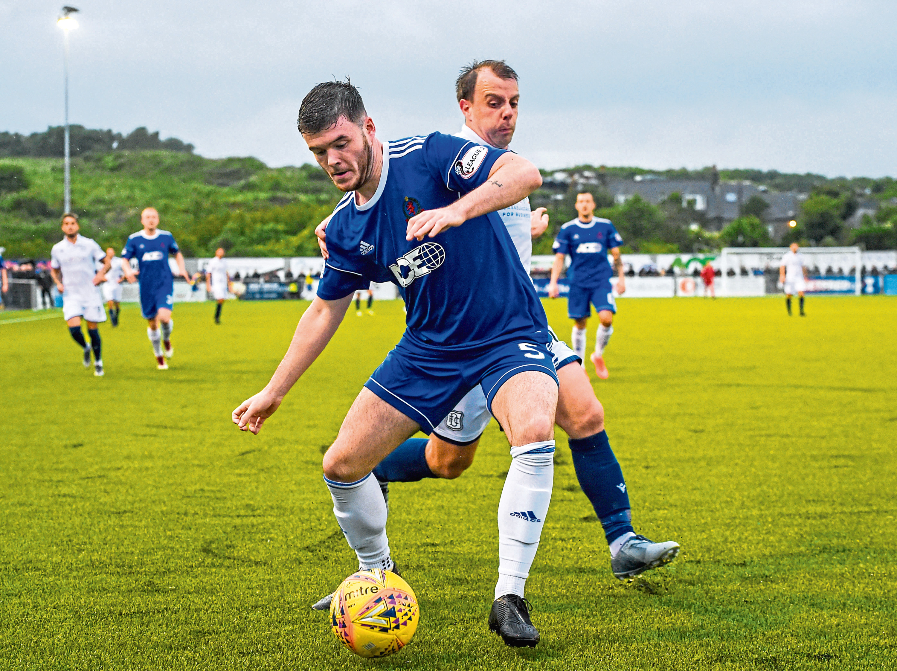 Cove Rangers Daniel Higgins and Paul McGowan in action