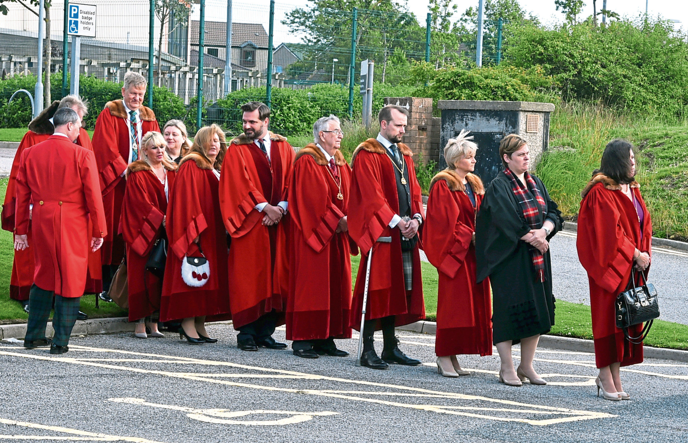 Friends and colleagues gather in civic red robes for the funeral of Bridge of Don councillor Sandy Stuart, who died on Wednesday aged 86