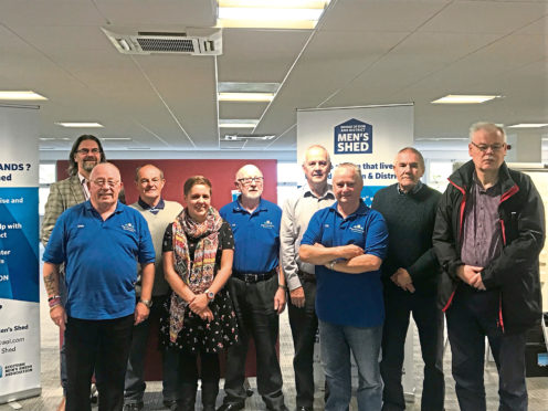 The Bridge of Don and District Men's Shed group with MP Kirsty Blackman and Jason Schroeder, executive officer of the Scottish Men's Sheds Association
