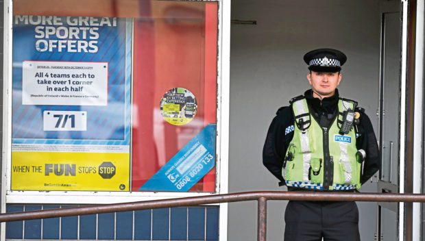 Police at the William Hill shop in Summerhill following the robbery which took place in October last year