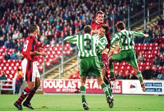 Aberdeen defender Brian Irvine climbs high at Pittodrie