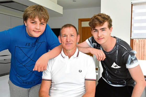 Brothers Wullie, left, and Alex Crawford, with rescuert Chay Clark