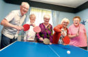 Aberdeen's Sports Awards nominee Janice Hutchison organises at a weekly table tennis session for the elderly at Lord Hay's Court, King Street, Aberdeen. In the picture are from left: John Duthie, Elsie Wood, Janice Hutchison, Pat Robertson and Evelyn Cooper Picture by Jim Irvine