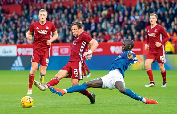 Aberdeen's Jon Gallagher (left) in action against RoPS of Finland in the Europa League