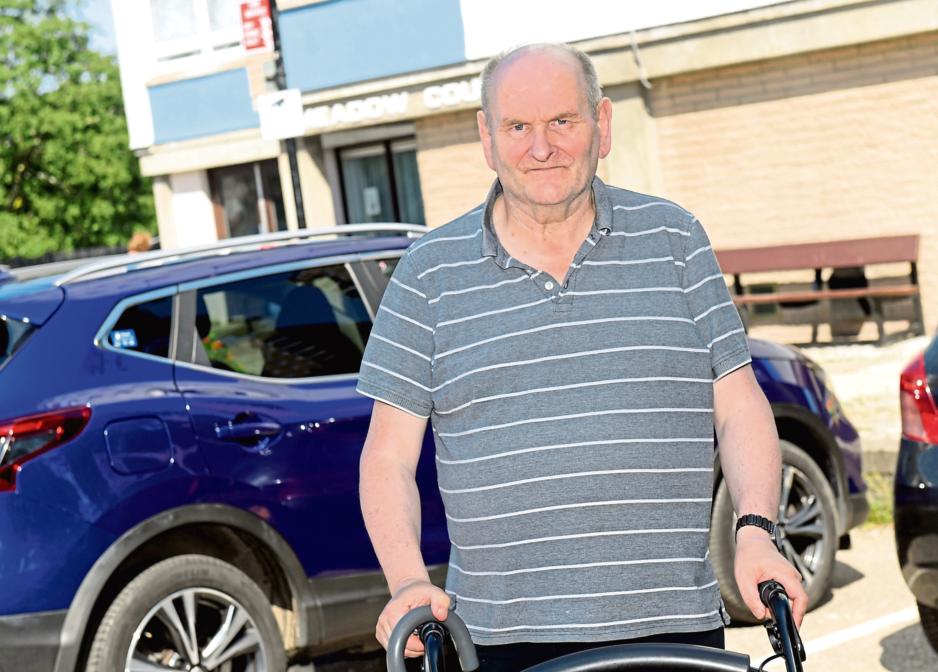 Peter Forbes, who suffers from Parkinson's, was left waiting at the roadside