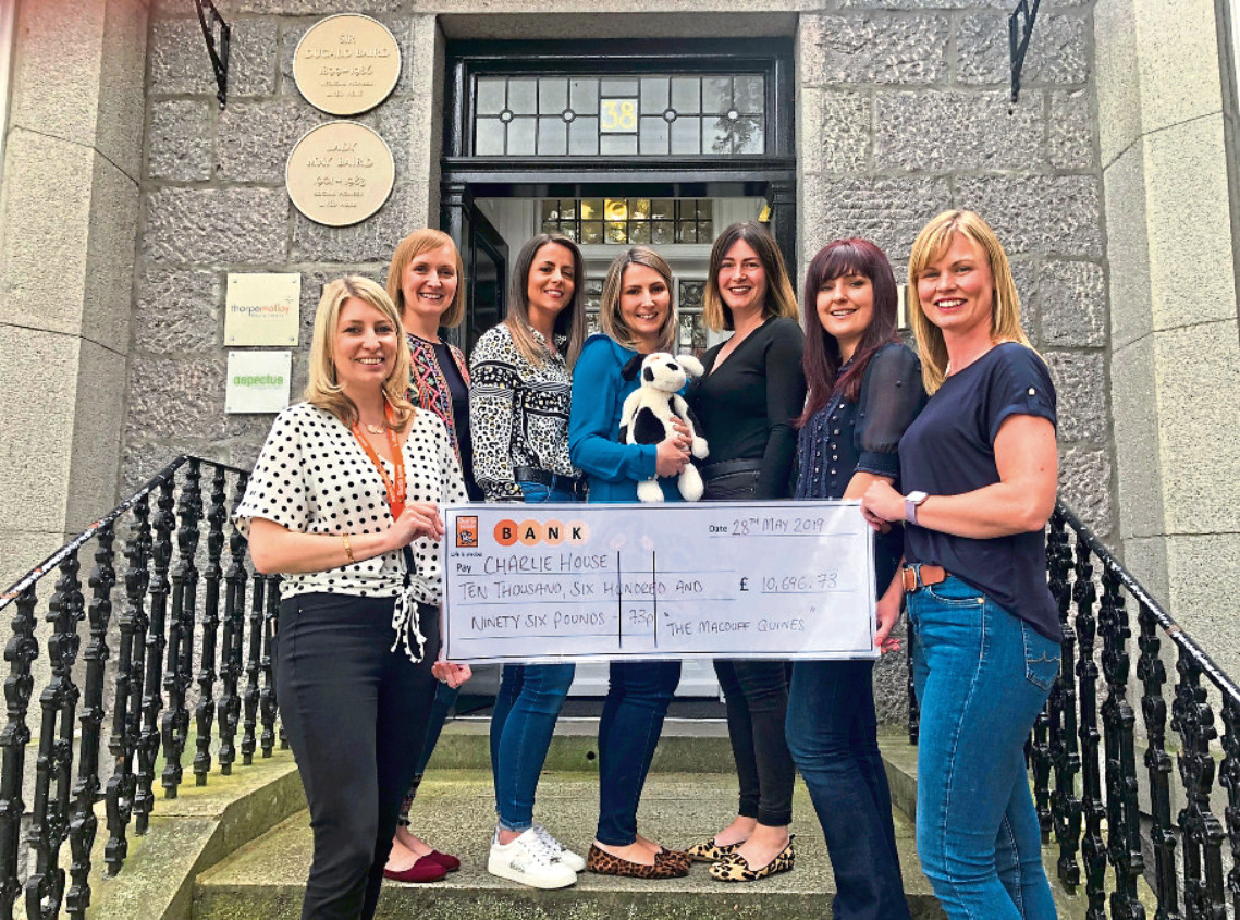 A group of fundraisers from Banff have raised money for Charlie House in memory of their friend Andrew Stuart