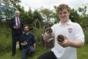 Councillor Philip Bell and Andrew Ferguson, operations officer with Scottish Natural Heritage, with Jyden Kinnaird, Junior Ranger at Lochside Academy, 14YO S4, holding some of the 'Beastie House' shelters made during the sessions