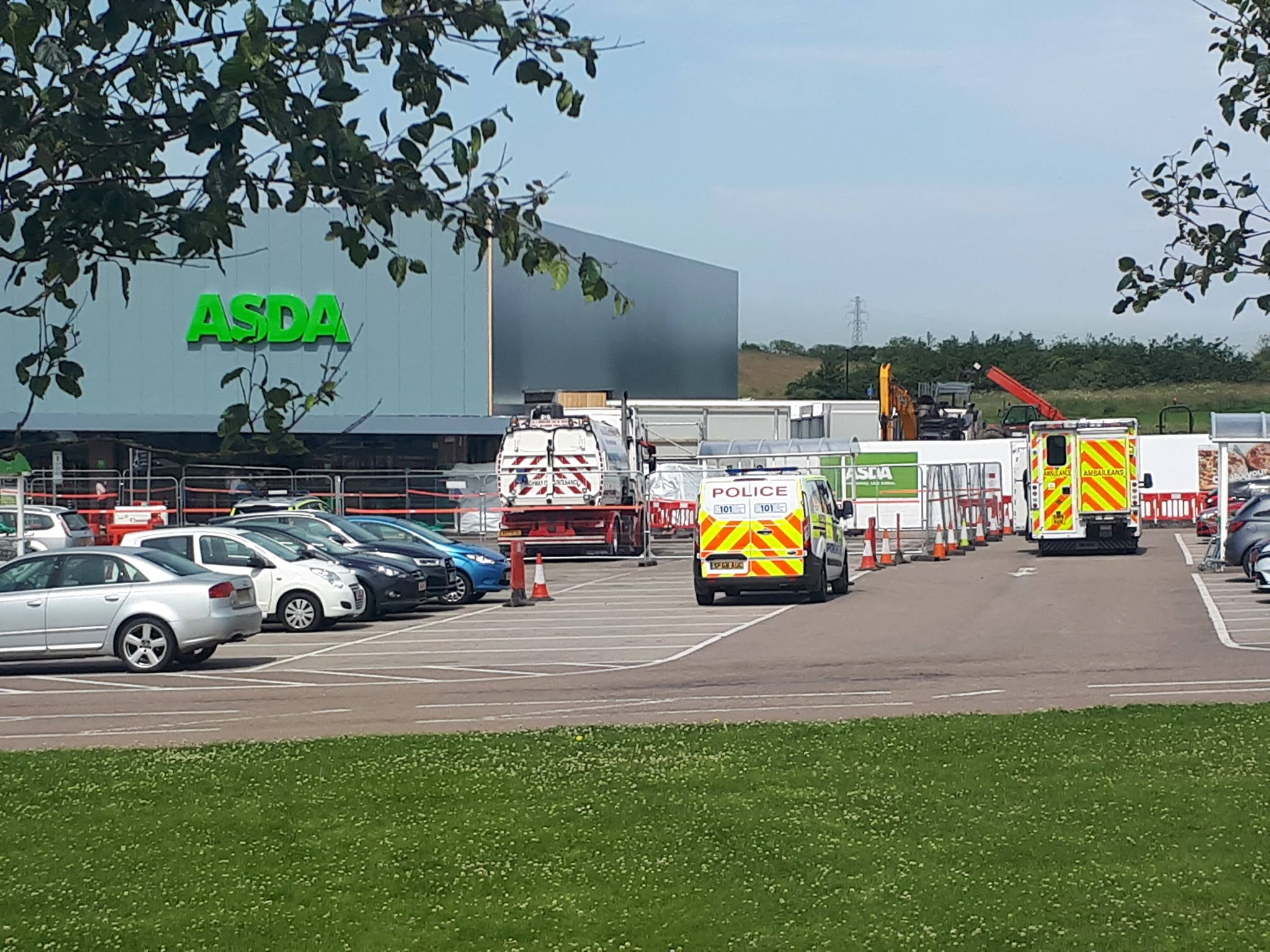 Police and ambulance crews were seen at the Asda in Peterhead