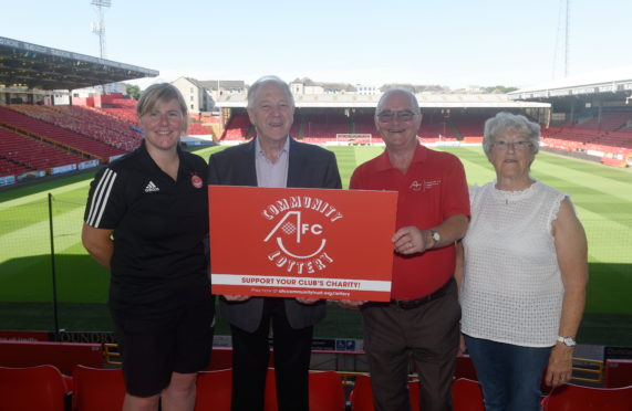 Pictured are from left, Claire Garrett (senior community projects officer), Craig Brown, Ronnie Kain and Kathleen McHaffie at Aberdeen Football Club as they launch the Aberdeen Community Trust Lottery. Picture by Darrell Benns