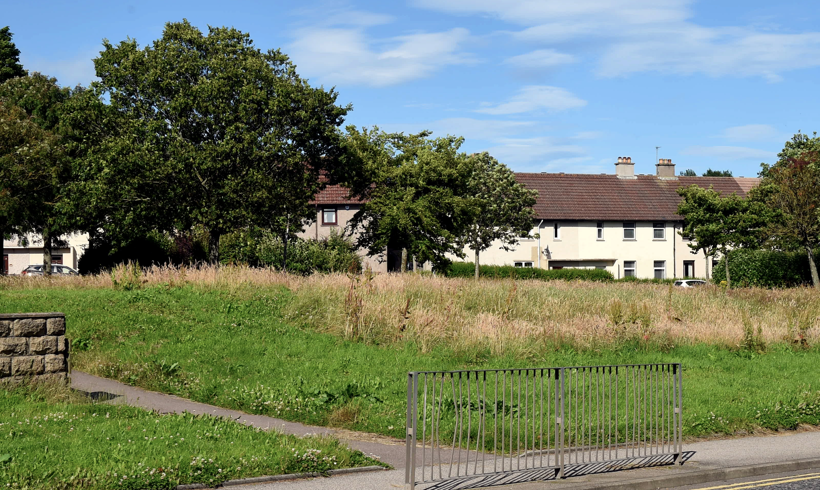 Residents in Garthdee have complained about the overgrown grass in the green spaces