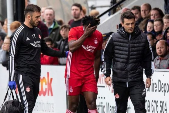 Aberdeen's Greg Leigh limps off injured in the first half against Inverness.