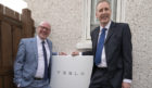 Kevin Stewart and Chris Hunt with one of the new Tesla units