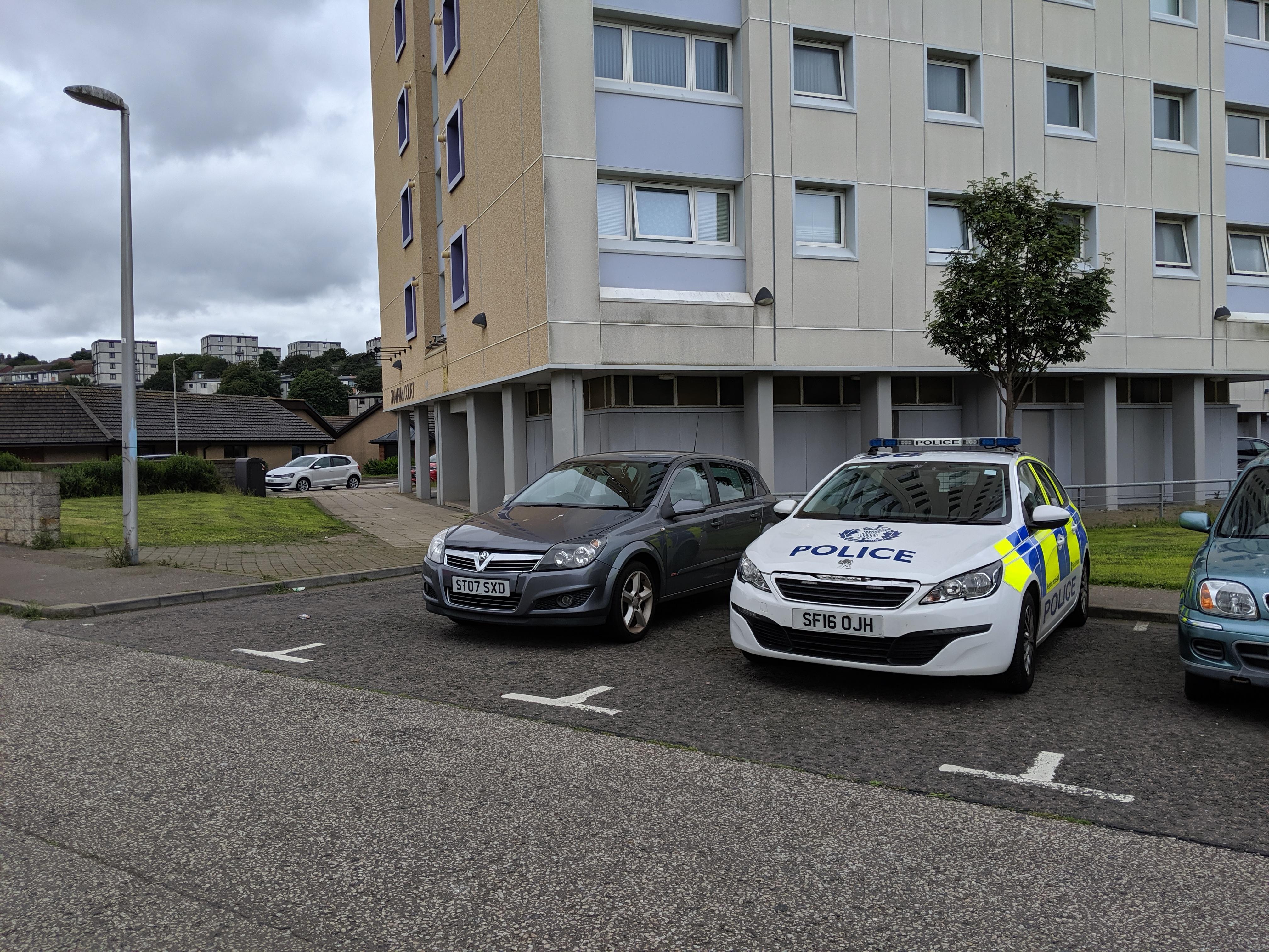 Police outside Grampian Court