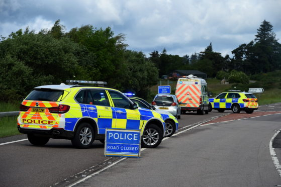 Police at the scene of yesterday's crash on the A96