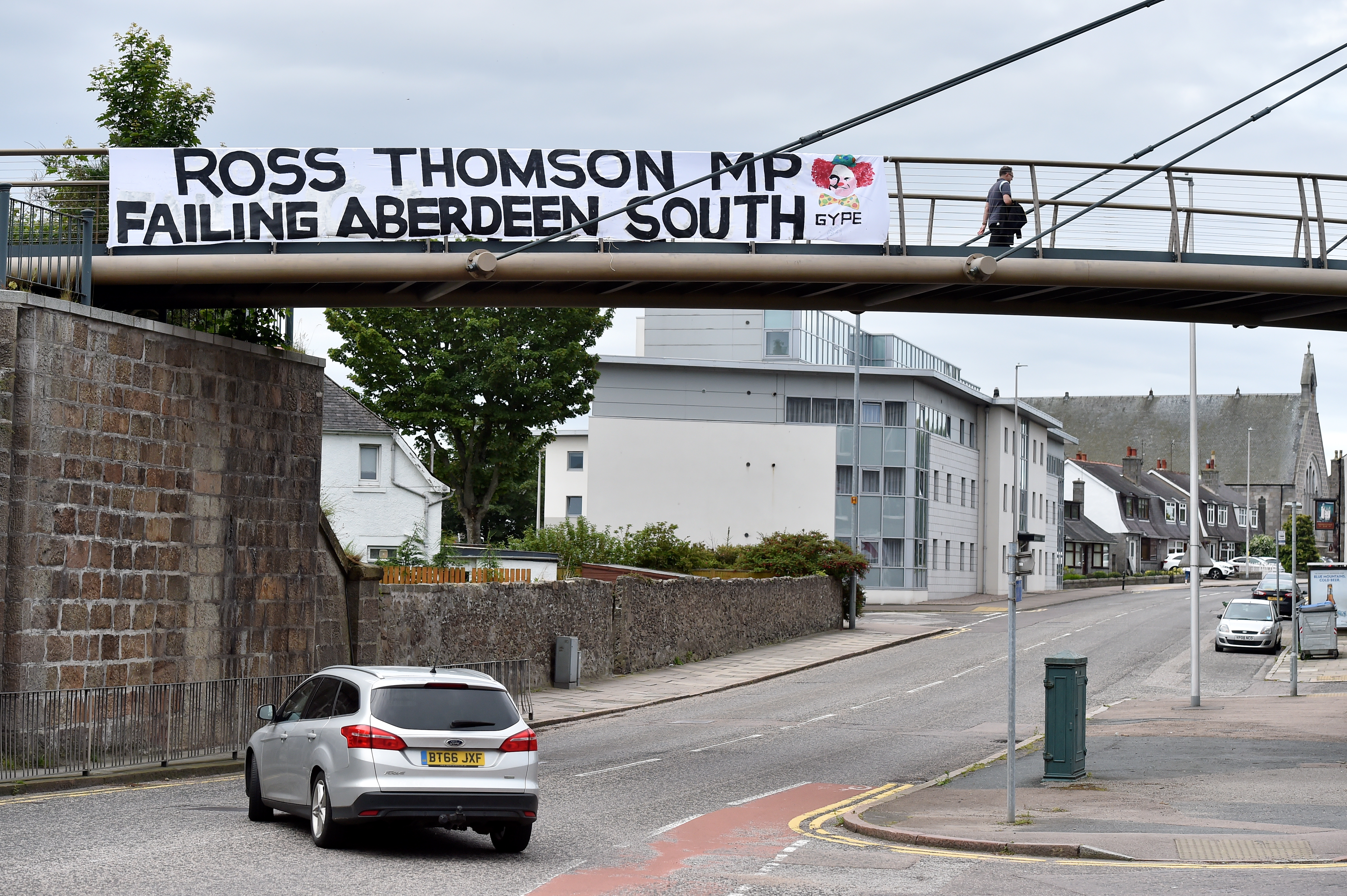 The banner is hanging from the Deeside Line bridge over Holburn Street