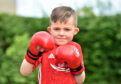 Connor has a brain condition, but is a kickboxer and is nominated for the Inspiration Award.  Picture by Scott Baxter