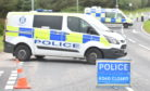 Officers at the scene of a crash on the A948