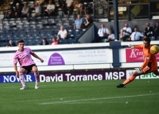 Peterhead's Ben Armour scores.