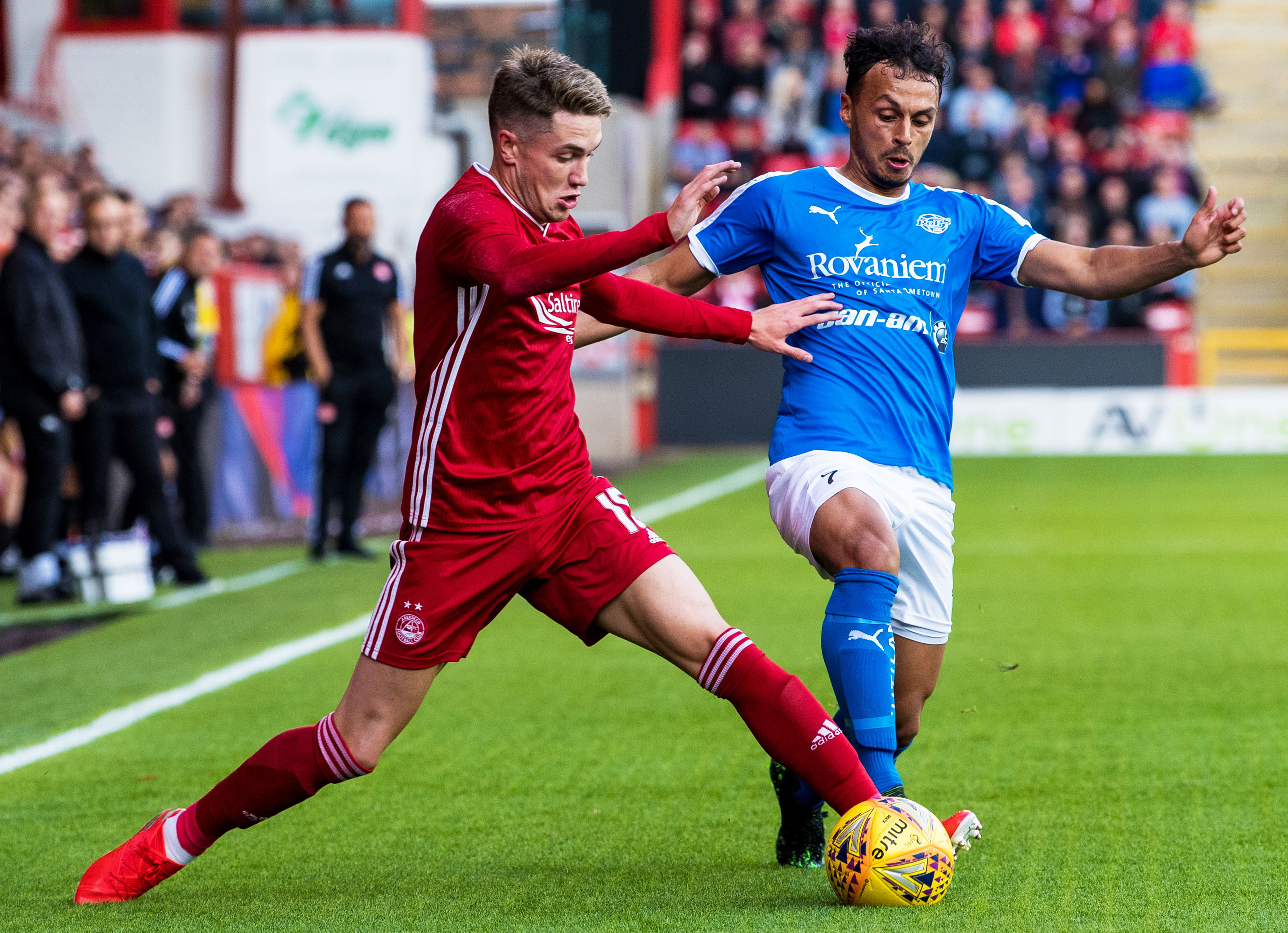 Aberdeen's Scott Wright, left, in action with RoPS' Youness Rahimi.
