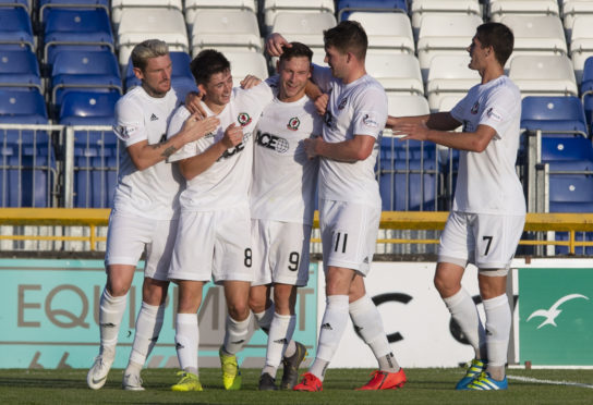 Mitch Megginson celebrates with team-mates.