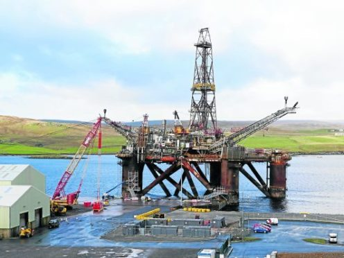 The Buchan Alpha floating production facility being decommissioned alongside Lerwick's quayside