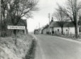 Pictured is the start of the Main Street at Tomintoul, 1976