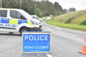 Police at the scene of the crash on the A948