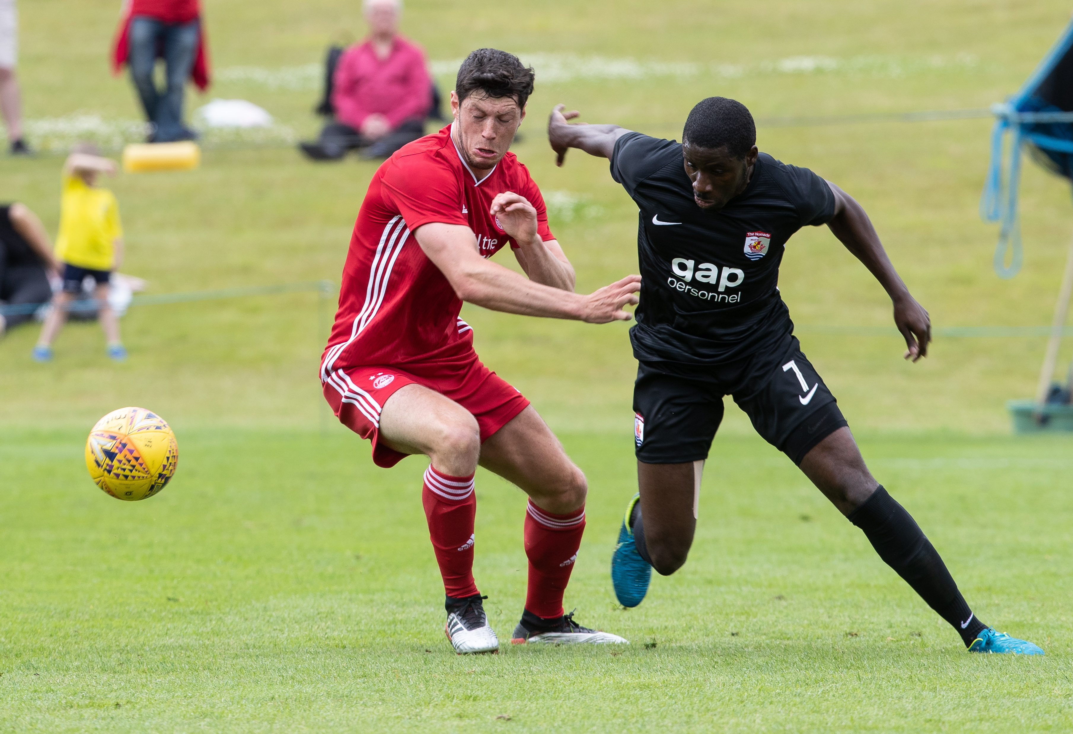 Aberdeen's Scott McKenna battling for the ball against Connah's Quay Nomads.
