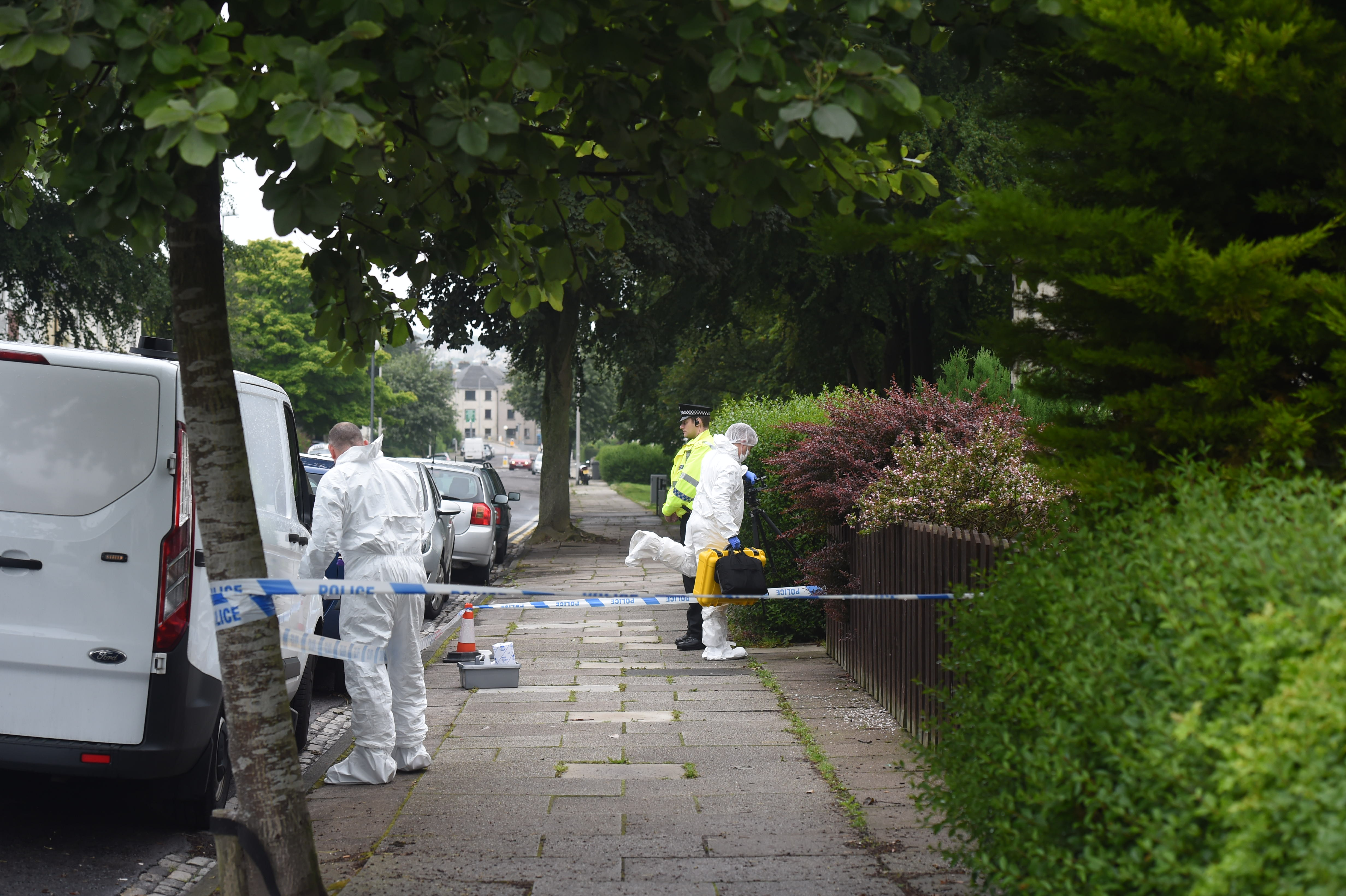 Police and forensics officers at the scene on Clifton Road this morning
