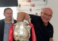 Aberdeen City Council co-leader Douglas Lumsden (left) and Aberdeen legend Willie Miller making the draw for this season's Aberdeenshire Cup.